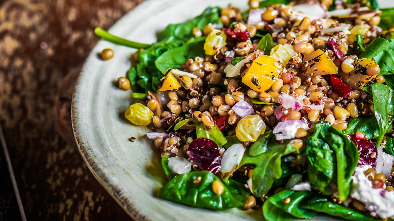 Spinach Salad with Tomato, Pine Nuts & Dried Fruit Image